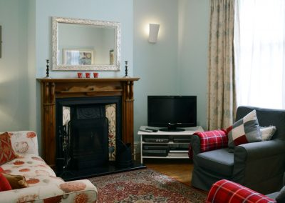 Photo: Cosy lounge with sofa and 2 arm chairs