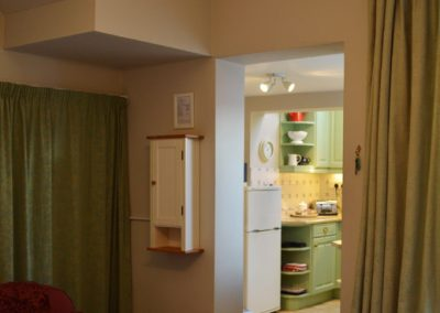 Photo: The dining room opens onto the kitchen