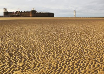 Photo: The beach at New Brighton with Fort Perch Rock and lighthouse